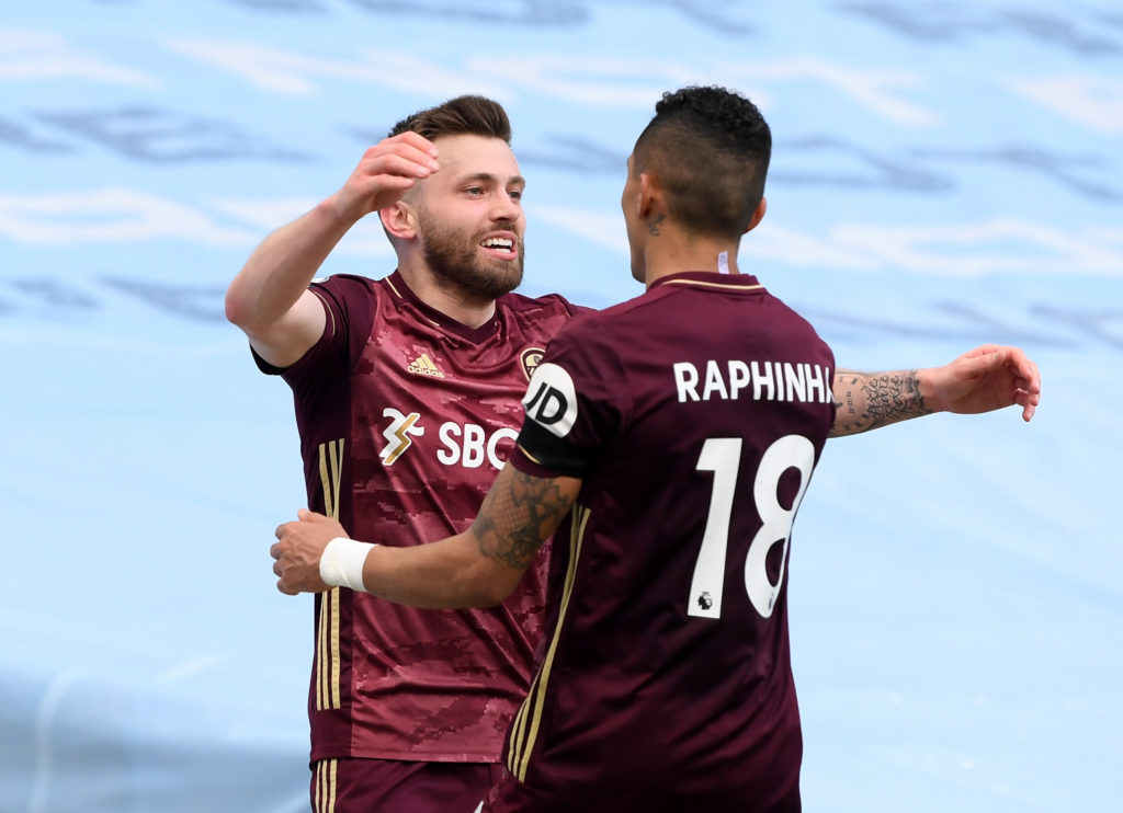 Raphina celebrating by hugging a teammate - mid-priced FPL midfielders
